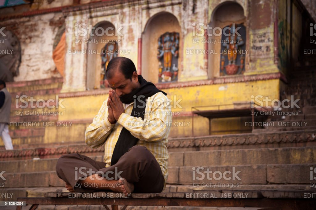 Meditation at Near Ganga River, Varanasi, India. stock photo
