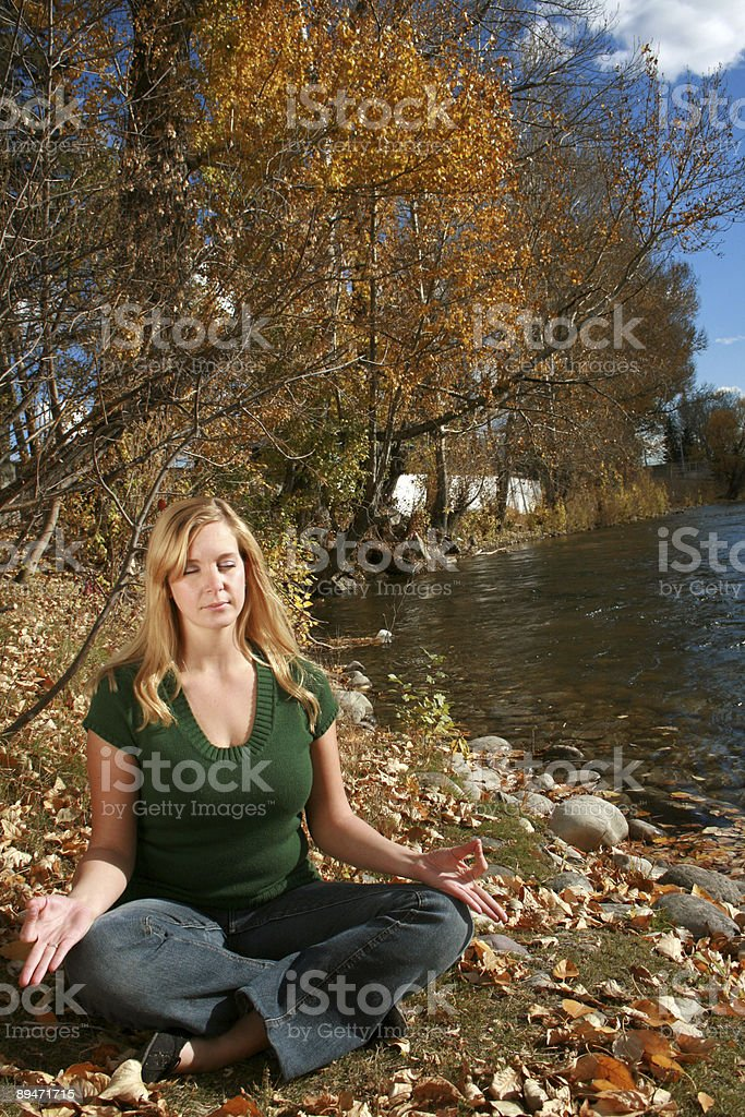 Meditation by the river royalty-free stock photo