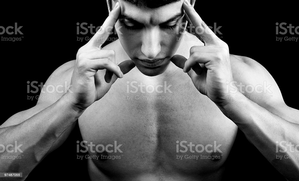 Meditation concept - muscular man in deep concentration royalty-free stock photo