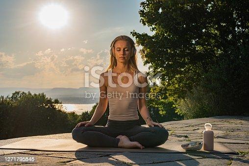 Outdoors yoga at sunrise in public park.