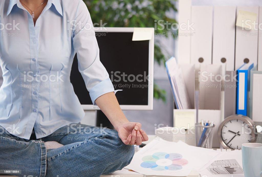Meditation in office stock photo