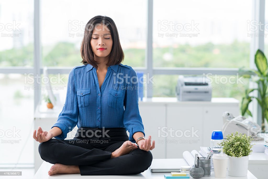 Meditation in office stock photo