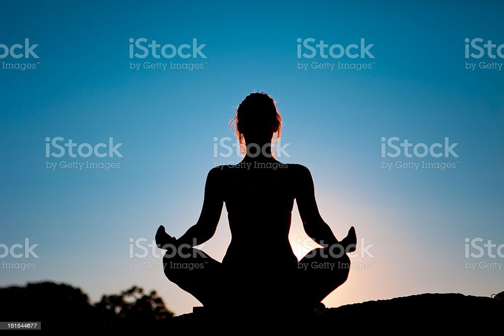 Meditation in sunset stock photo