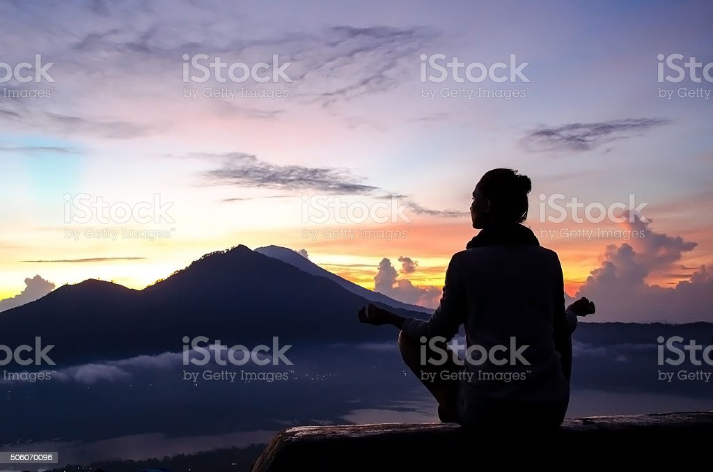 Meditation in the mountains stock photo