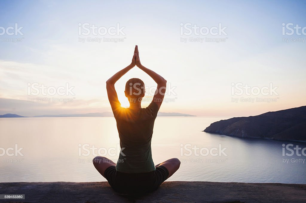 Meditation outdoors stock photo