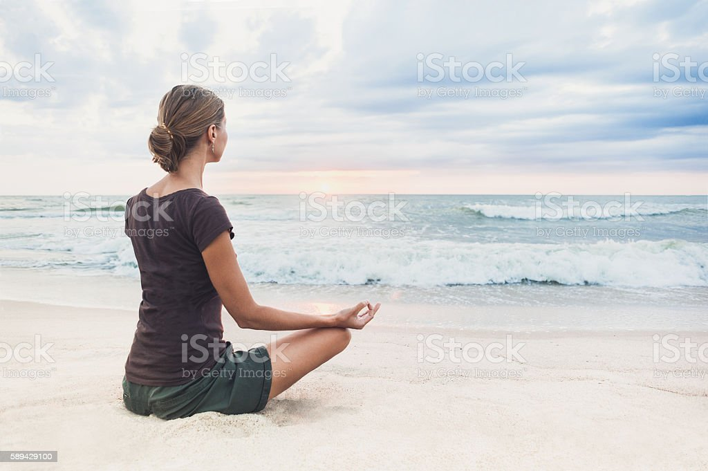 Meditation outdoors stock photo