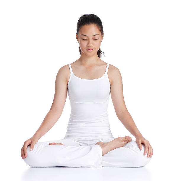 meditation female asian teenager doing meditation against white background lotus position stock pictures, royalty-free photos & images