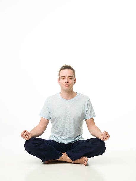 meditation handsome caucasian man sitting in lotus position, meditating on white studio floor cross legged stock pictures, royalty-free photos & images