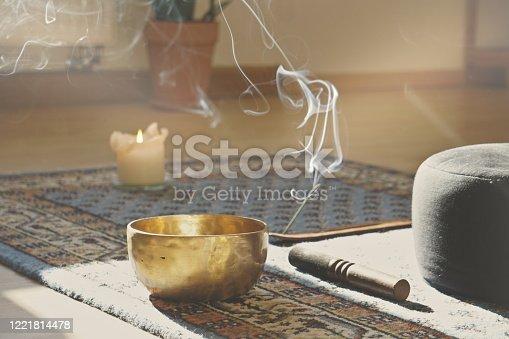 istock meditation room with singing bowl 1221814478
