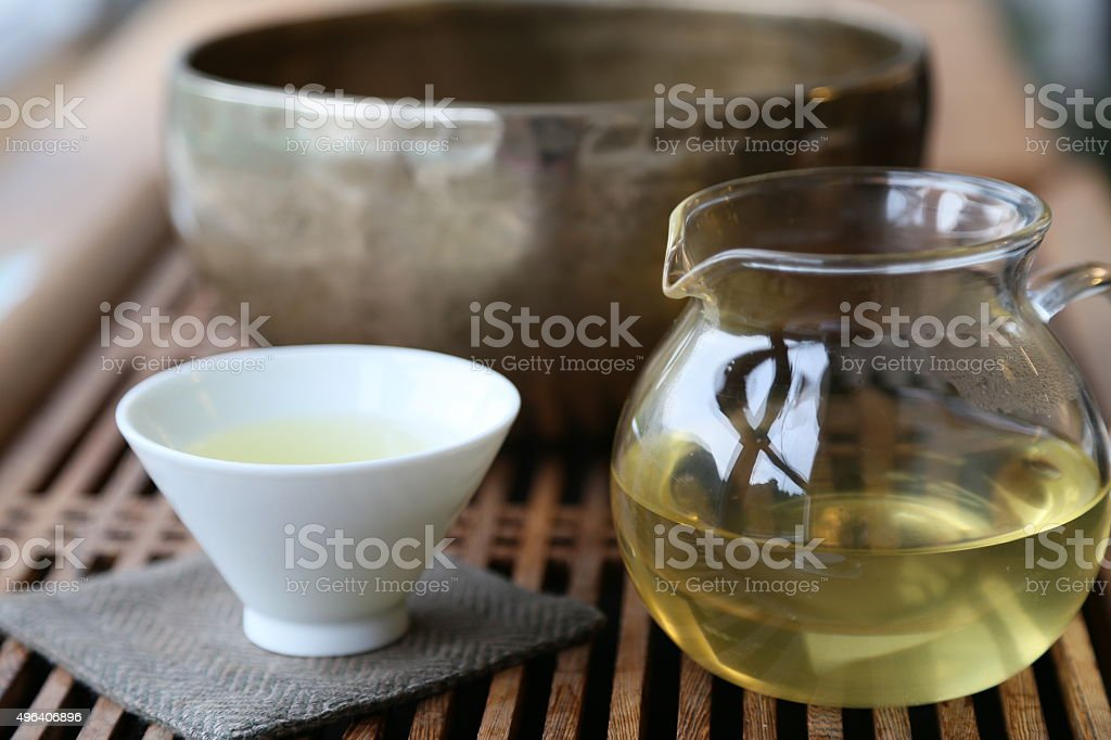 Meditation with Tea and singing bowl stock photo