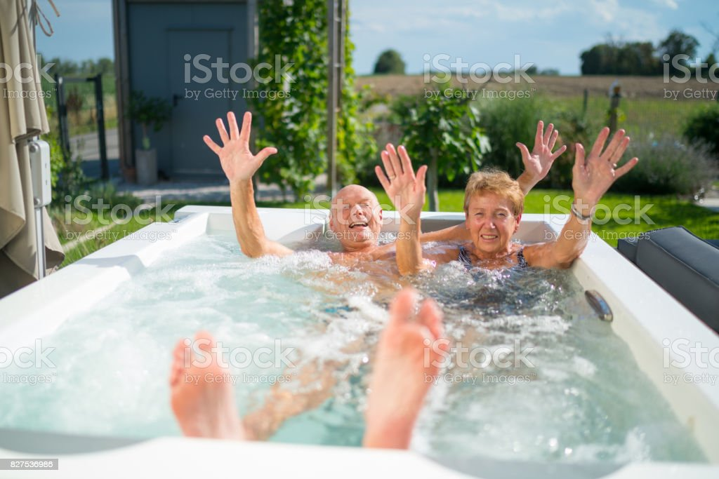 Mediterranean Active Seniors, funny couple in jacuzzi стоковое фото