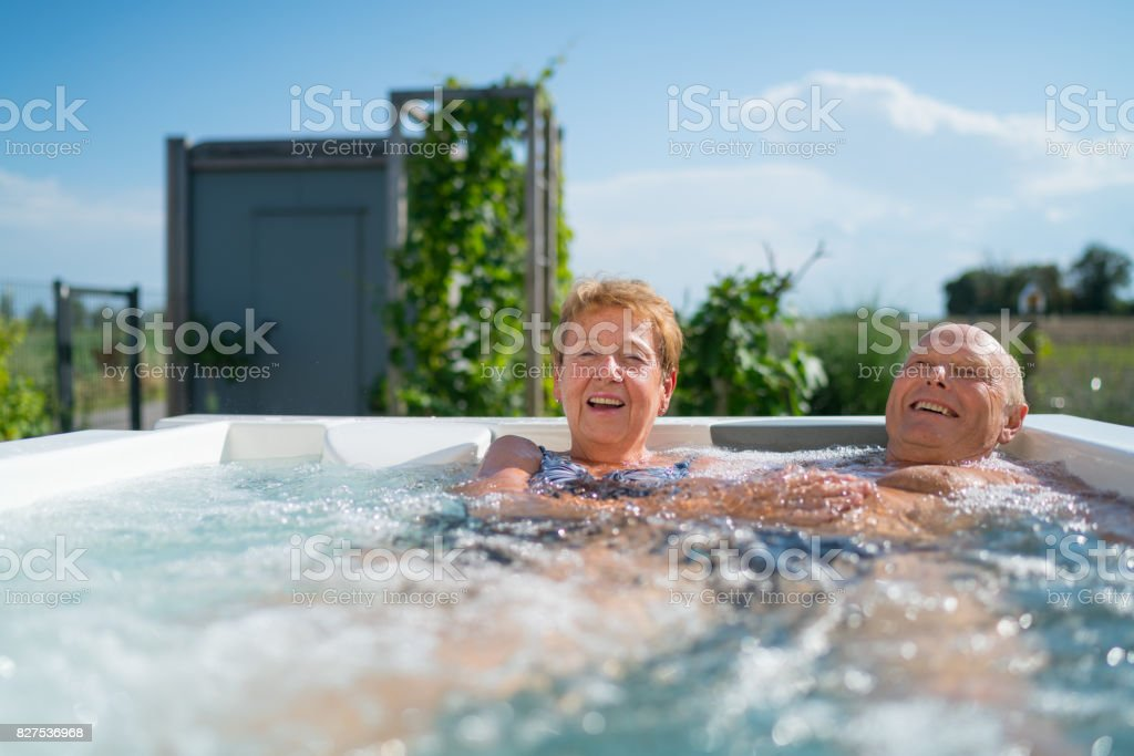 Mediterranean Active Seniors, happy couple in jacuzzi стоковое фото
