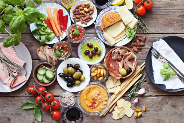 mediterranean appetizers table concept. diner table with tapas selection: cured meat and salami, gazpacho soup, jamon, olives, cheese, hummus and vegetables. - mediterranean food imagens e fotografias de stock