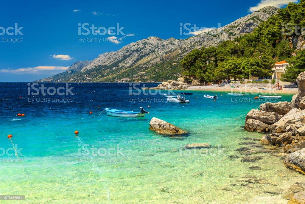 Mediterranean bay and beach with motorboats, Brela, Dalmatia region, Croatia stock photo