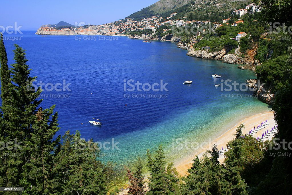 Mediterranean Beach in Adriatic Sea - Dubrovnik on horizon, Croatia stock photo
