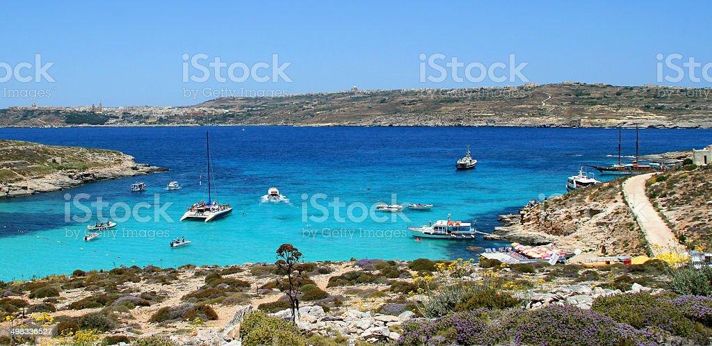Mediterranean beach with yachts stock photo