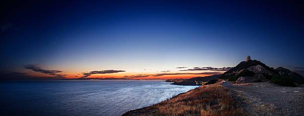 Mediterranean coast at dusk near an ancient coastal tower stock photo