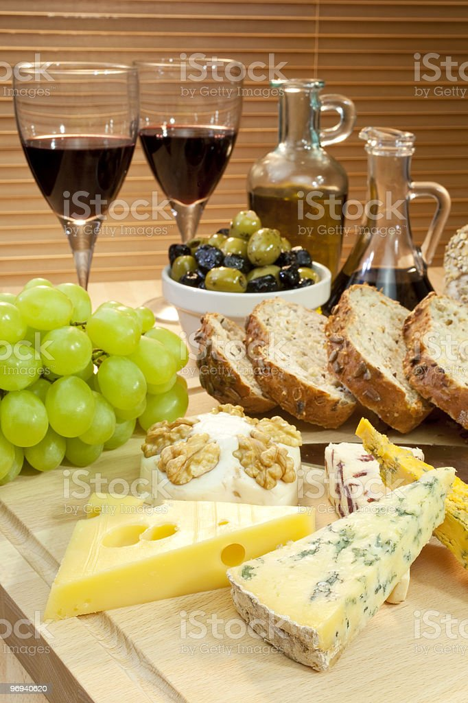 Mediterranean Diet of Cheese, Wine, Grapes, Olives, Bread, Balsmaic Vinegar royalty-free stock photo