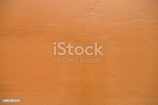 Typicall Mediterranean clay plaster surface, adobe sandy texture with tiny hair cracks