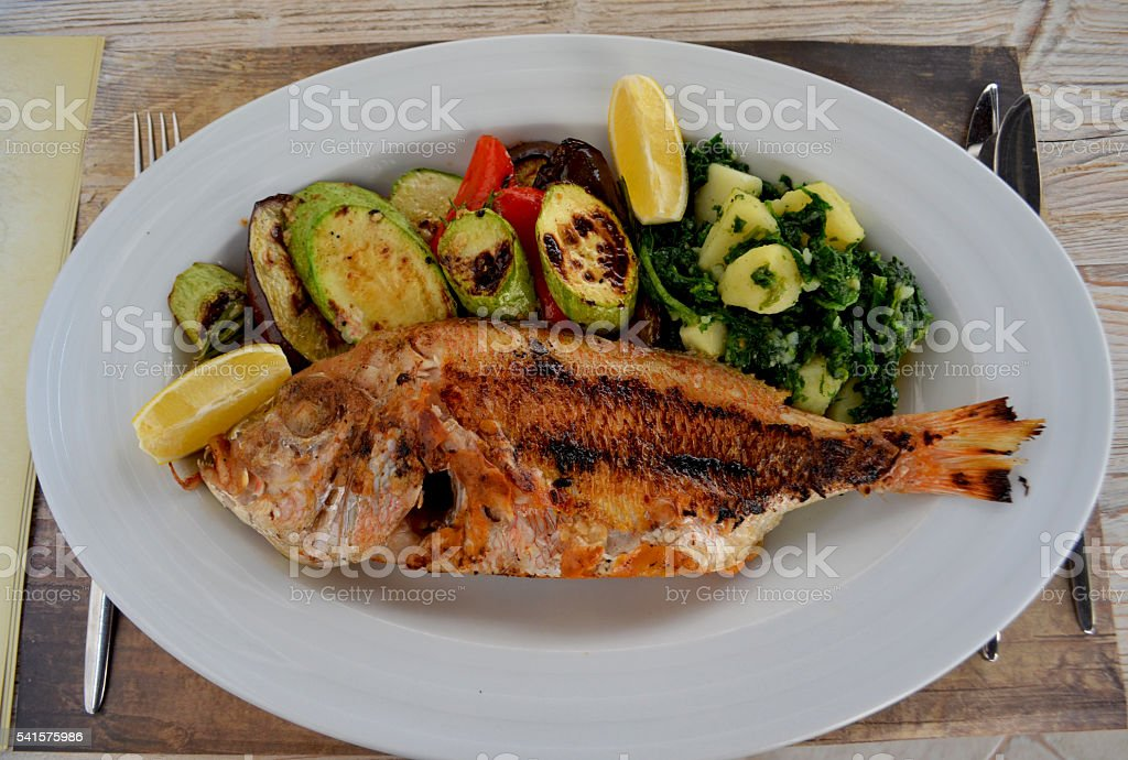 Mediterranean fish restaurant stock photo