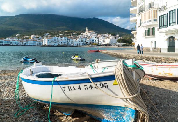 Mediterranean fishing boat on the shore stock photo
