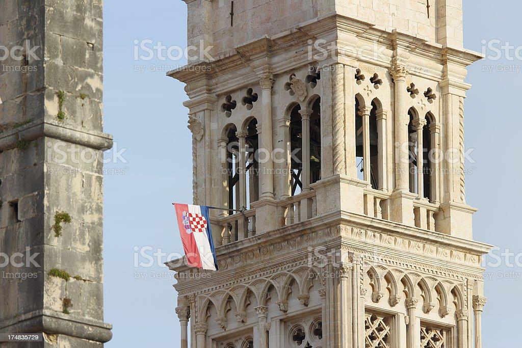mediterranean historic church bell towers with flag Trogir Croatia royalty-free stock photo