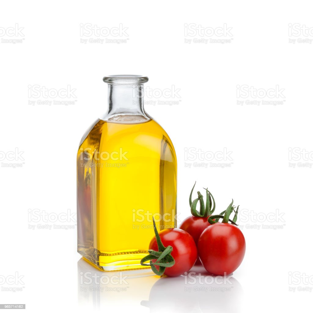 Mediterranean ingredients: Olive oil and tomatoes - Royalty-free Bottle Stock Photo