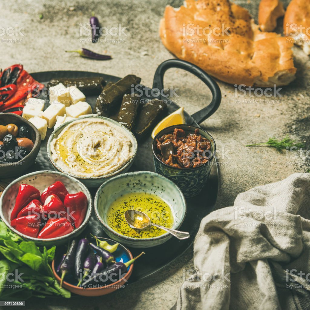 Mediterranean meze starter fingerfood platter, square crop stock photo
