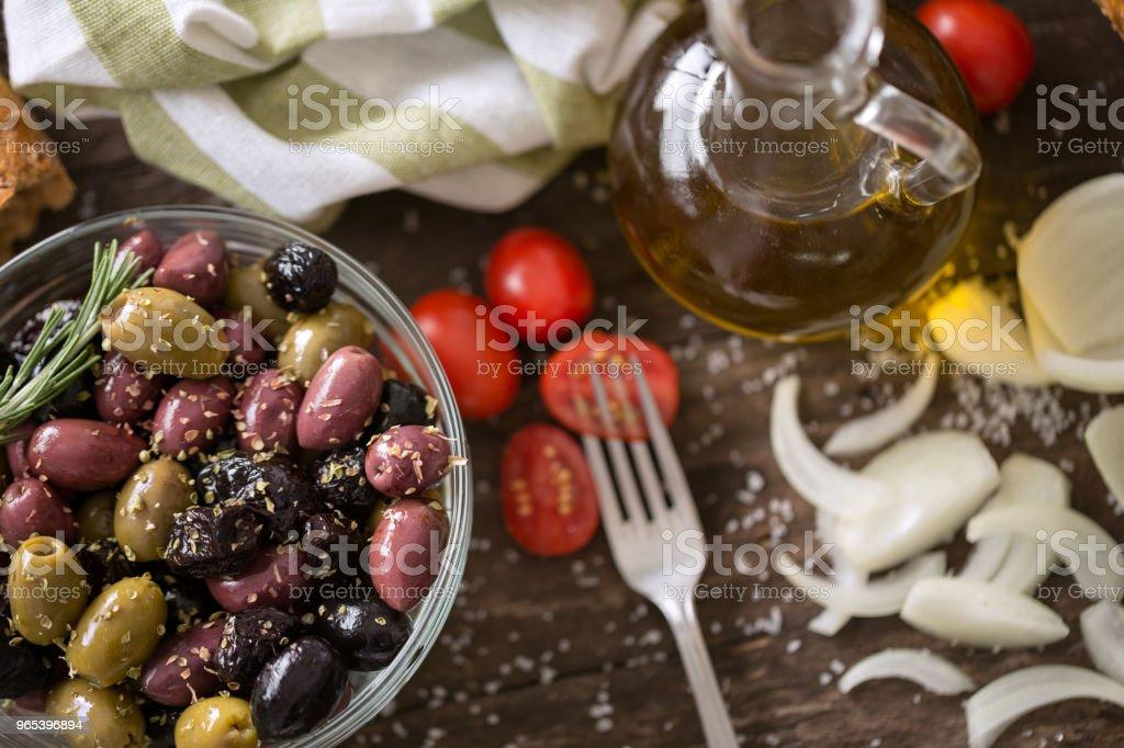 Mediterranean mix of olives for salad in oil zbiór zdjęć royalty-free