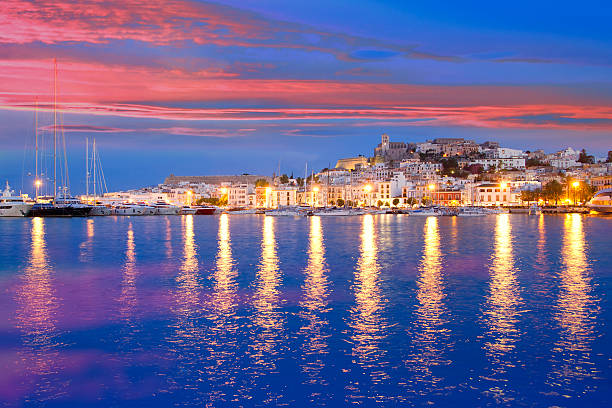 Mediterranean night view of Ibiza Island with water and stock photo