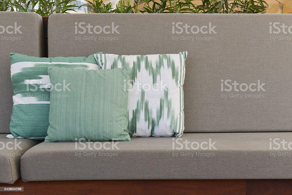 Mediterranean pillows over outdoors sofa stock photo