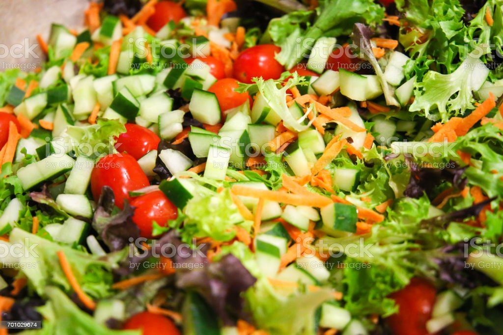 Mediterranean salad mix Fine chopped salad mix with lettuce, tomato, cucumber and carrots Chopped Food Stock Photo