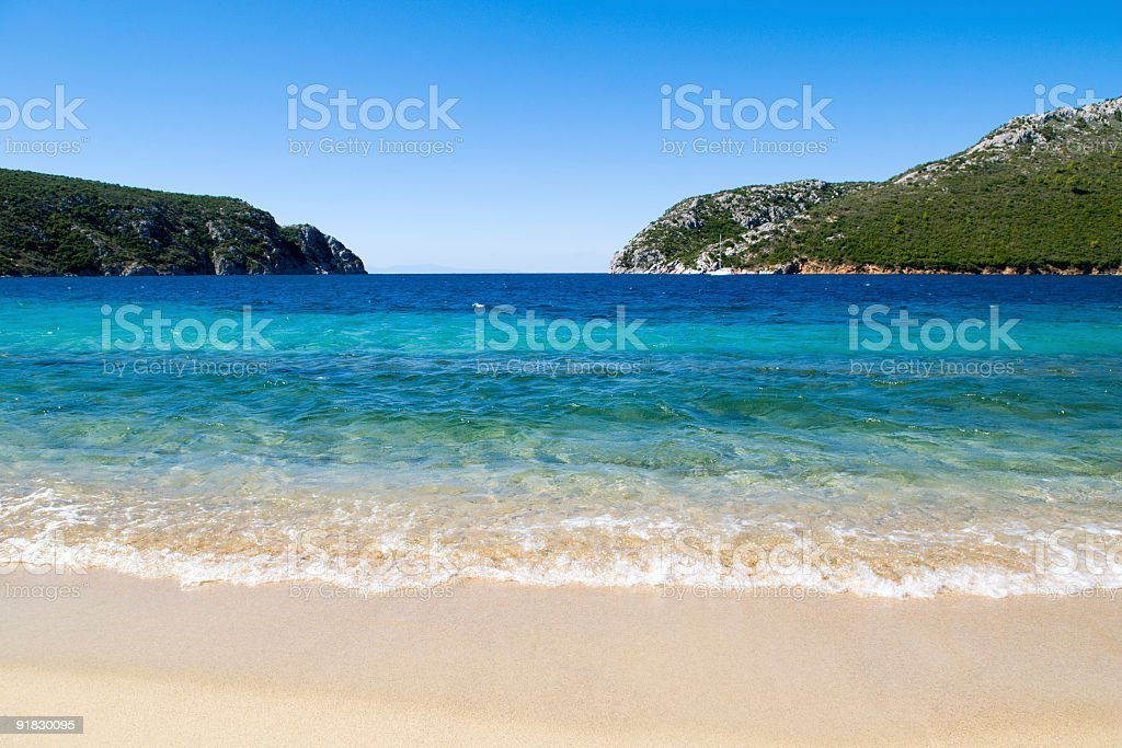Mediterranean sea and blue sky, lonely beach in summer holidays stock photo