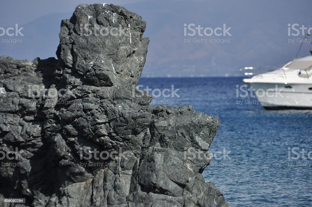 Mediterranean sea. The view from the rocks on the island and boat. stock photo