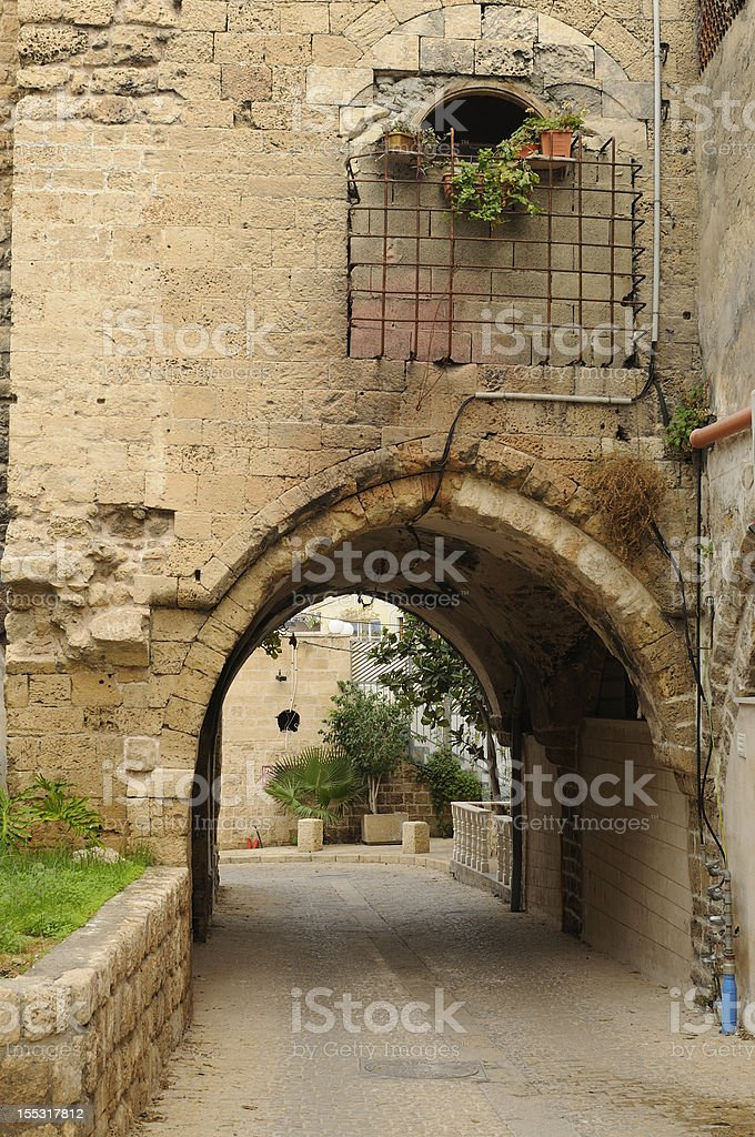 Mediterranean stone alley and tunnel royalty-free stock photo