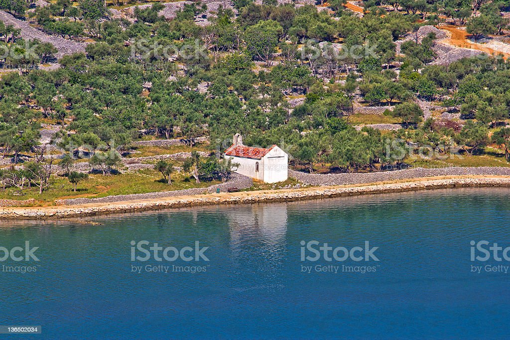 Mediterranean style chapel by the sea stock photo