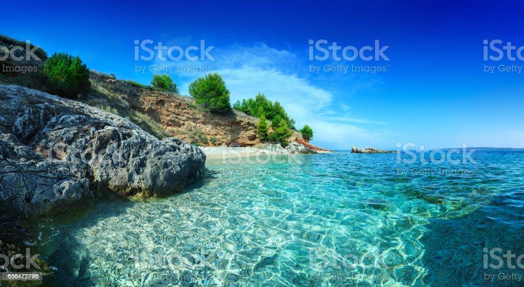 Mediterranean Sunny Beach, crystal clear water in Adriatic Sea Mediterranean Sunny Beach, crystal clear water in Adriatic Sea Adriatic Sea Stock Photo