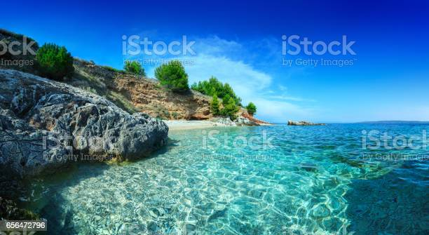 Mediterranean Sunny Beach Crystal Clear Water In Adriatic Sea Stock Photo - Download Image Now