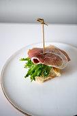 istock Mediterranean tapas delicious ham with lettuce 1224107532