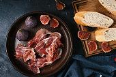 istock Mediterranean tapas, spanish, food, dark concrete, delicious ham, italian antipasti snacks, cherry ham, skewers, skewers 1213683153