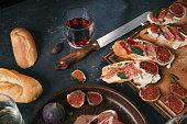 istock Mediterranean tapas, spanish, food, dark concrete, delicious ham, italian antipasti snacks, cherry ham, skewers, skewers 1213683210