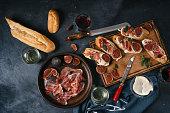istock Mediterranean tapas, spanish, food, dark concrete, delicious ham, italian antipasti snacks, cherry ham, skewers, skewers 1213683221
