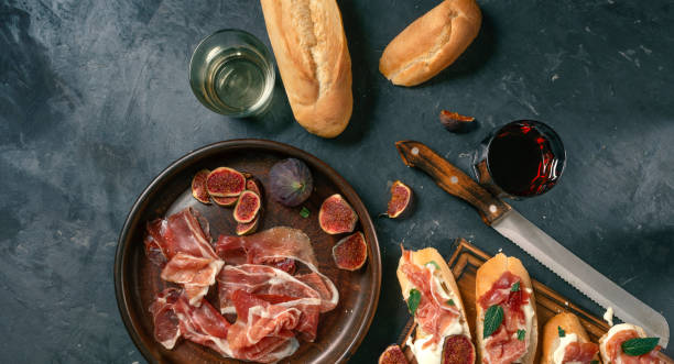 Mediterranean tapas, spanish, food, dark concrete, delicious ham, italian antipasti snacks, cherry ham, skewers, skewers stock photo