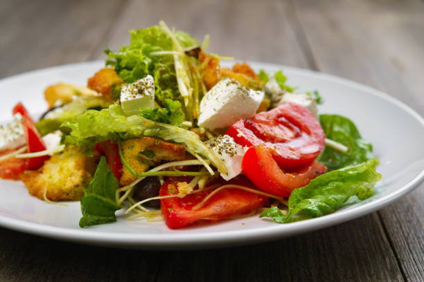 Mediterranean vegetable letuce and croutons salad stock photo