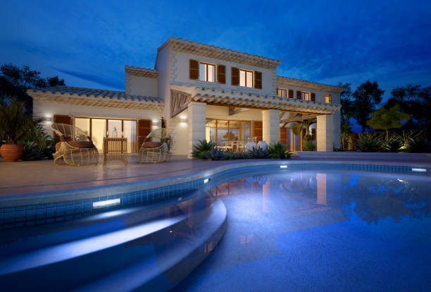 Mediterranean villa with swimming pool External view of a modern house with pool at dusk stone house stock pictures, royalty-free photos & images