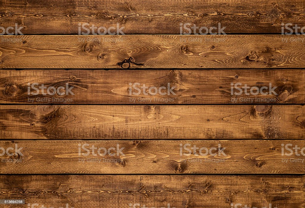 Medium brown wood texture background viewed from above. The wooden...