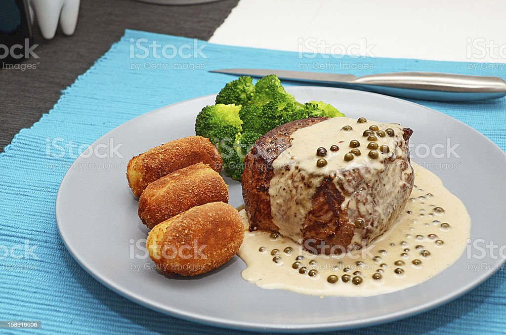 Medium grilled beef steak with pepper sauce stock photo
