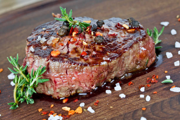 medium grilled steak - beef stock pictures, royalty-free photos & images