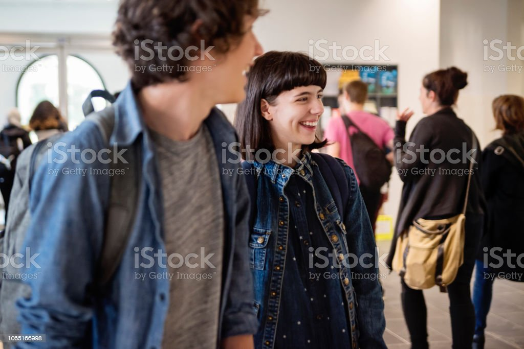 Medium group of students going in and out College University lobby. stock photo