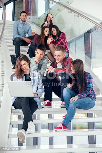 istock Medium group of  students studying on steps of school building. 469275410